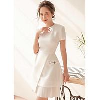 Đầm trắng thêu dập li