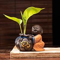 Tượng phong thủy chú tiểu trồng cây chữ Tâm