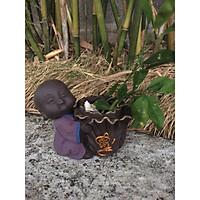 tượng chú tiểu ôm chậu cải trồng cây phong thủy