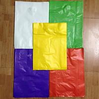 Túi Nilong Màu HD Có Quai Xách Bịch 1Kg Gói Hàng ,Đựng Hàng Size 25x35cm (Giao màu ngẫu nhiên)