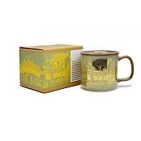 Cốc cà phê Đại Hội An  Đông Gia-màu men hỏa biến tự nhiên vàng xanh mạ vàng.