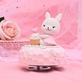 Hộp nhạc Sakura Thỏ váy hồng ôm giỏ hoa anh đào
