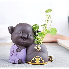 Tượng heo trồng cây chữ Lộc