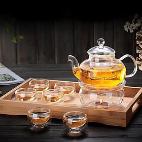 Bộ ấm gồm 6 chén và đế nến châm trà
