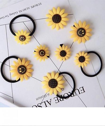 Cột tóc , kẹp tóc  hoa hướng dương - combo 2 món