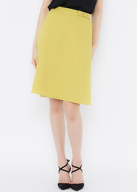 Chân váy vàng chanh xòe xéo lưng đính nơ