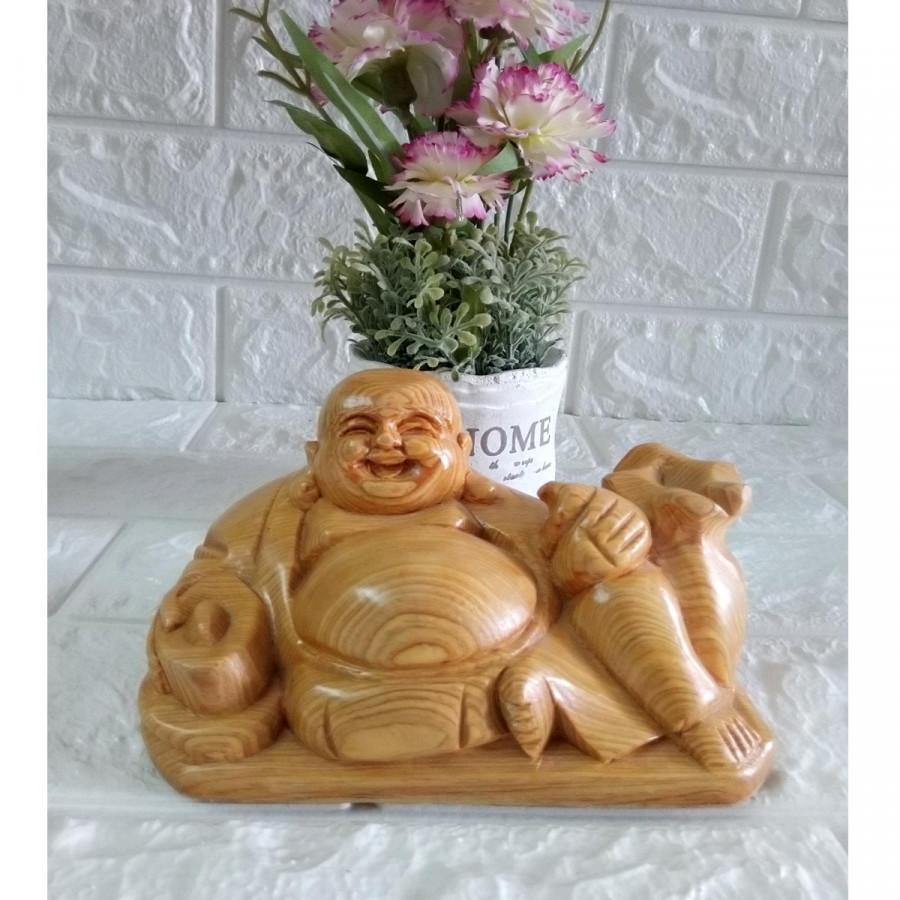 Tượng phật di lặc ngồi cầm vàng gỗ pơ mu PMN14