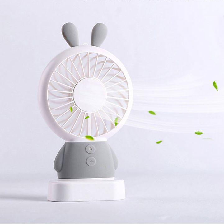 Quạt mini cầm tay sạc điện USB dáng tai Thỏ với đèn LED chuyển màu có thể để trên bàn bằng đế nhựa - 2365019 , 3114620164299 , 62_15459376 , 150000 , Quat-mini-cam-tay-sac-dien-USB-dang-tai-Tho-voi-den-LED-chuyen-mau-co-the-de-tren-ban-bang-de-nhua-62_15459376 , tiki.vn , Quạt mini cầm tay sạc điện USB dáng tai Thỏ với đèn LED chuyển màu có thể để t
