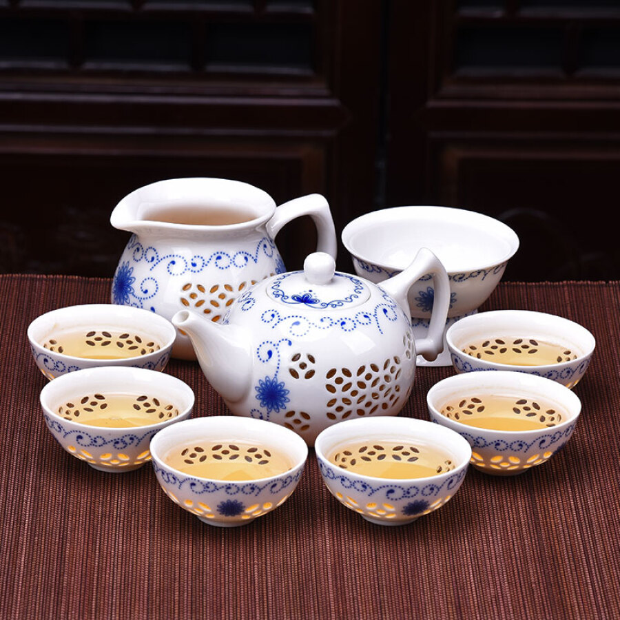 Haofeng set of exquisite blue and white porcelain hollow Kung Fu tea set home household ceramic teapot cover bowl tea cup gift [Linglong...