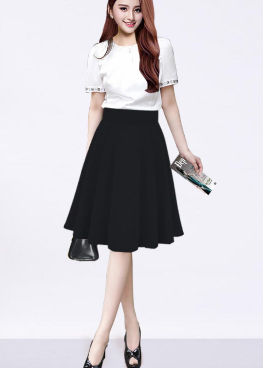 1105200332865 - Chân váy xòe có kèm quần bên trong màu đen