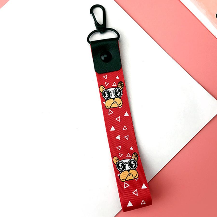 Móc khóa dây Strap dây vải hình chó đeo kính - đỏ