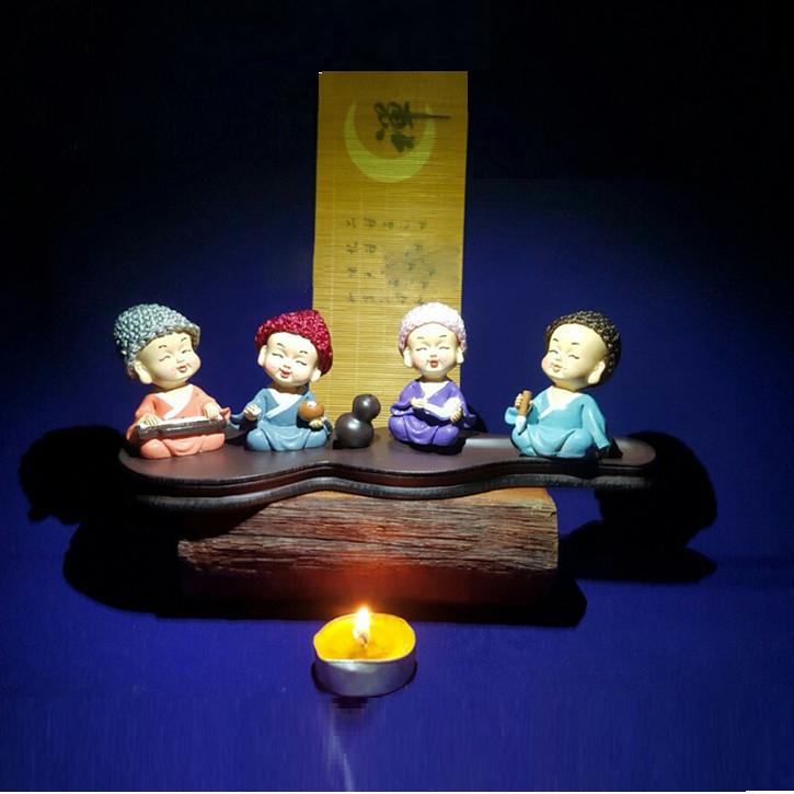 Bộ tượng 4 chú tiểu Cầm – Kì – Thi – Họa đội nón len