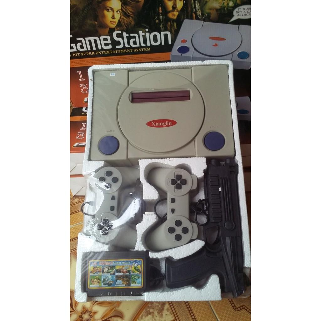 Máy chơi game 4 nút LT007 trắng tặng 1 băng game nhiều trò