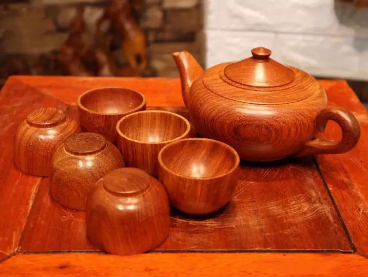 Bộ ấm chén pha trà gỗ hương tiện nguyên khối rơi không vỡ