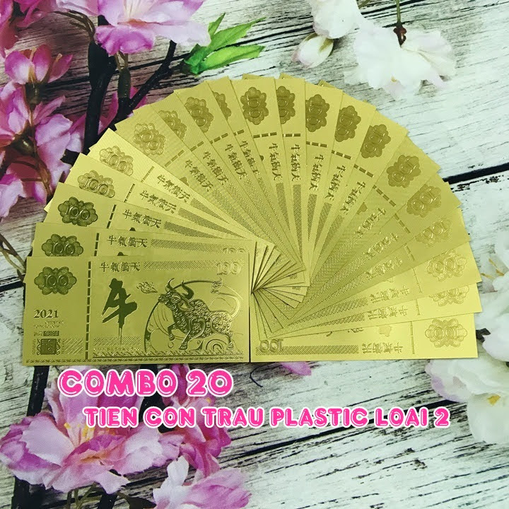 Combo 20 tờ lưu niệm 100 hình con Trâu màu vàng, chất liệu nhựa plastic, dùng để trang trí trong nhà, treo cây hoa mai, làm tiền lì xì, quà mừng dịp Lễ, Tết 2021