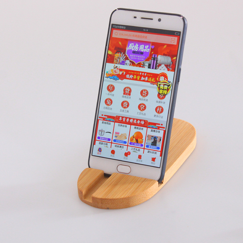 Giá gỗ đỡ điện thoại ipad bằng gỗ Tre chống mối mọt cong vênh,Để điện thoại đứng hay nằm đều được,Phù hợp với mọi điện thoại,Nhỏ gọn có thể bỏ túi hay balo được,Kích thước  17 x 7,6 cm,Màu Vàng gỗ tre - Giá đỡ Ipad máy tính bảng