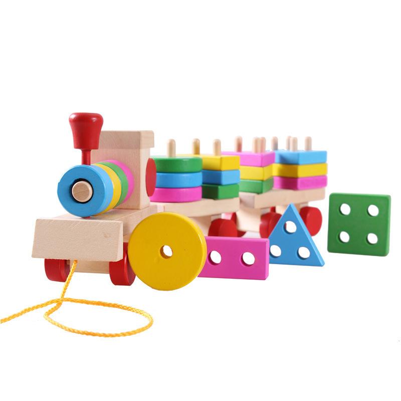 Đồ chơi tàu hỏa chở khối gỗ thả hình trụ cho bé