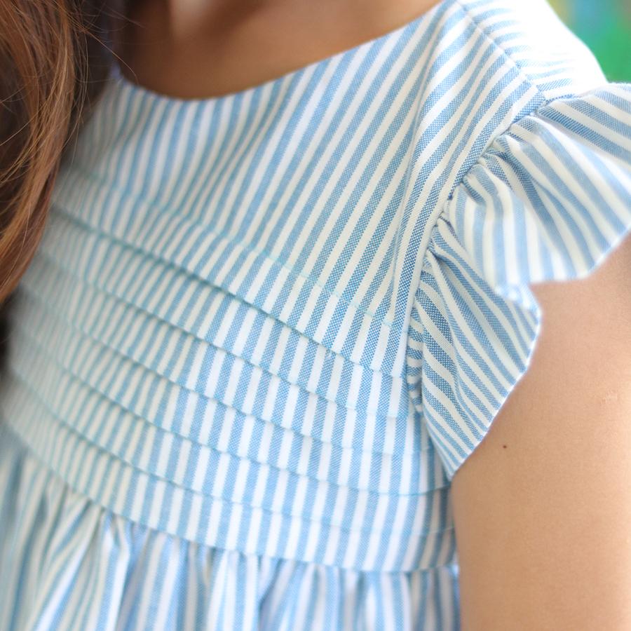 Đầm Bé Gái Kika Mầu Xanh Kẻ Gấp Ly Ngực K111