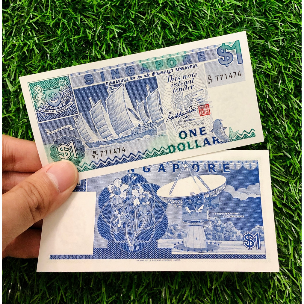 Tiền thuận buồm xuôi gió Singapore 1 đồng năm 1987 - tặng kèm bao lì xì - The Merrick Mint