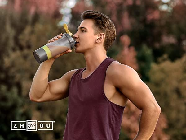 man drinking health drink while exercising outdoors