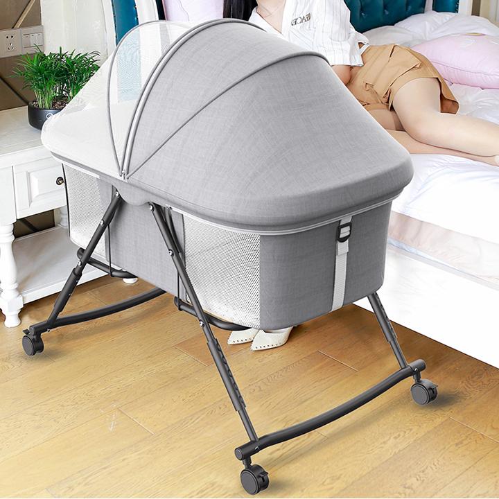 Giường cũi . nôi chơi cho bé có bánh xe , màn che muỗi côn trùng
