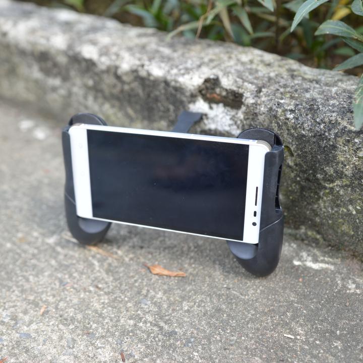 Tay cầm chơi game pubg mobile, hỗ trợ điện thoại nhiều kích thước, siêu nhẹ, có mút chống rung, chống trơn trượt.