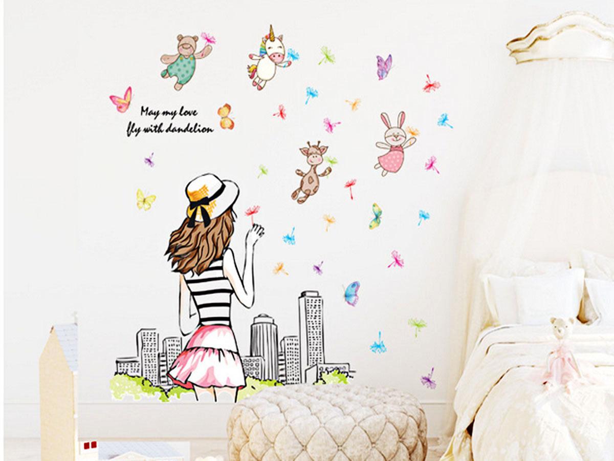 decal dán tường cô gái quay lưng thổi hoa