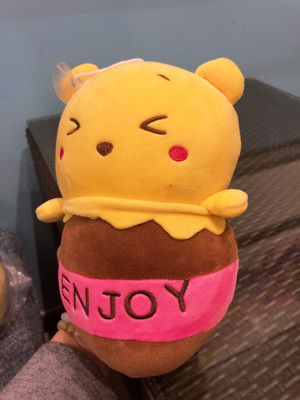 Gấu bông Pooh nằm hũ mật ong enjoy