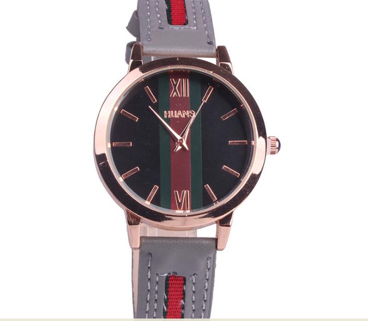 Đồng hồ nữ mặt tròn dây da