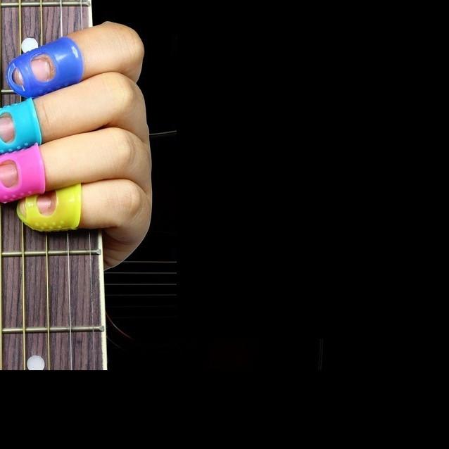 Móng cao su cho đàn guitar (bộ 4 móng )