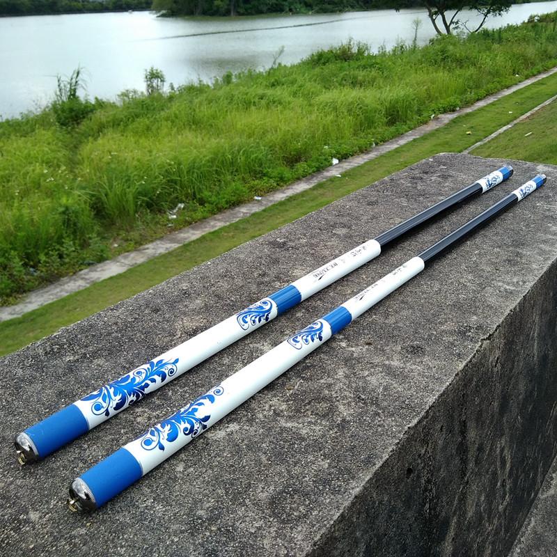 Cần câu cá carbon siêu cứng màu xanh trắng . Chất liệu cao cấp DCC05