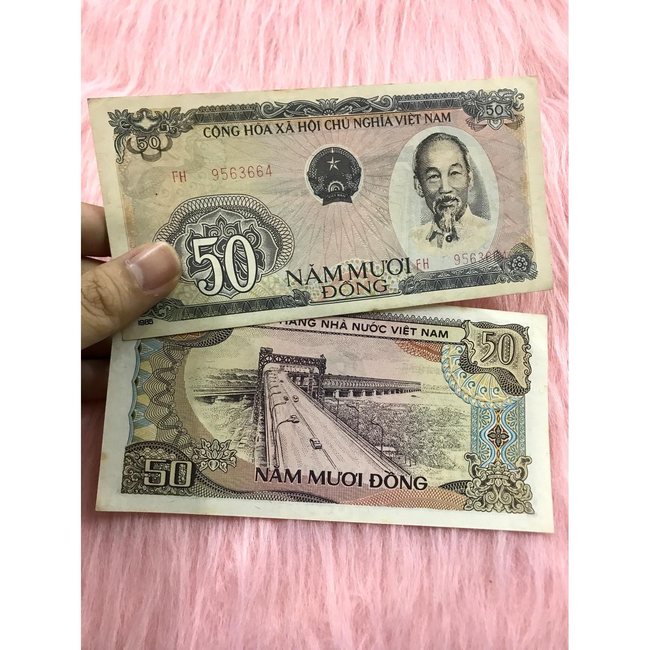 Tờ tiền 50 đồng 1985 , 50 đồng cầu Thăng Long Hà Nội , tiền cổ Việt Nam sau giải phóng đã hết lưu hành - tặng kèm bao lì xì đỏ - The Merrick Mint