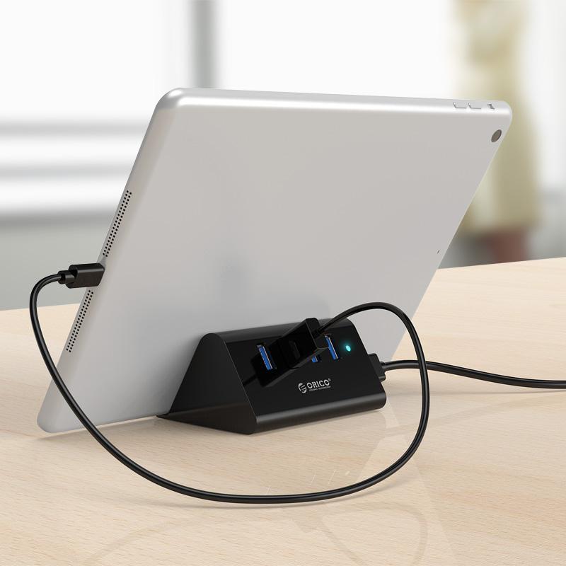 Hub chia 4 cổng USB 3.0 kèm đế đỡ điện thoại Orico SHC-U3 - Hàng nhập khẩu
