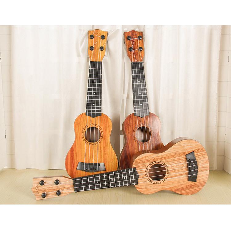 Đồ chơi đàn guitar mini vân gỗ cho trẻ tập chơi đàn