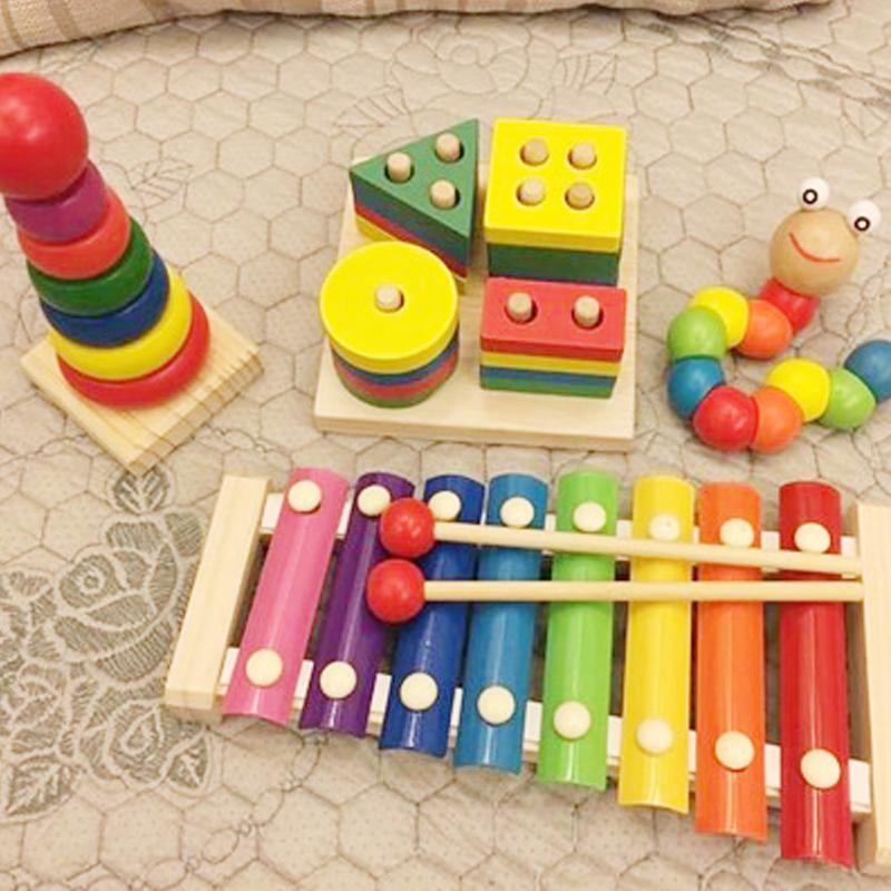 Bộ đồ chơi gỗ cho bé gồm 4 món GT ( Đàn gỗ, tháp cầu vồng, sâu gỗ, trụ 4 cọc)