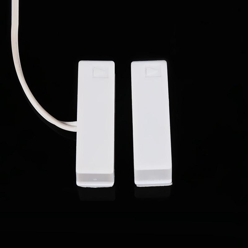 Báo động cửa mở cảm ứng từ có điều khiển từ xa B003 ( Đã kèm pin )
