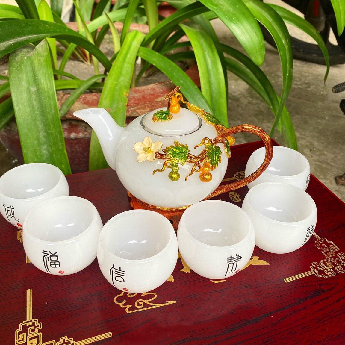 Bộ ấm trà chạm cây bầu với ly chạm chữ đá bạch ngọc
