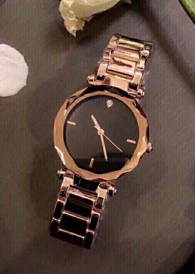 Đồng hồ nữ thời trang dây kim loại