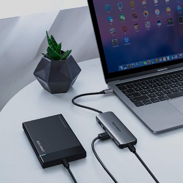 Hub USB Type-C ra 4 cổng USB 3.0 hỗ trợ cổng USB-C cấp nguồn chính hãng Ugreen 50980 cao cấp