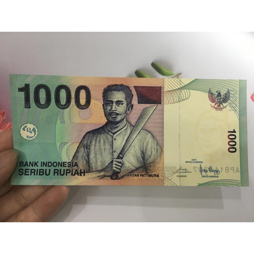 Tiền 1000 Rupiah của Indonesia người đàn ông cầm gươm , tặng phơi nylon bảo quản tiền