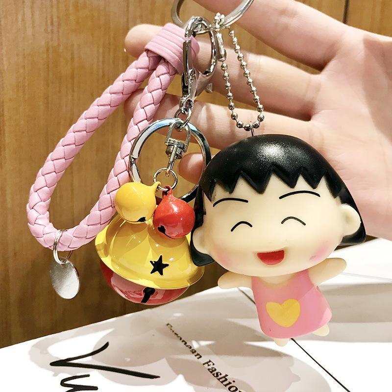 Móc khóa leng keng Maruko kute dây da bện tròn màu hồng